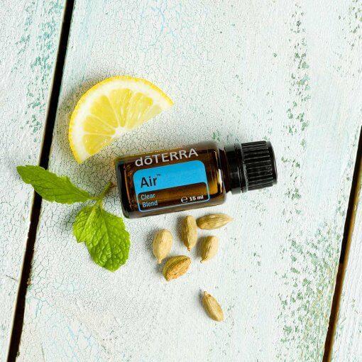doterra esencialny olej air s citronom, semiacka a mata na stole